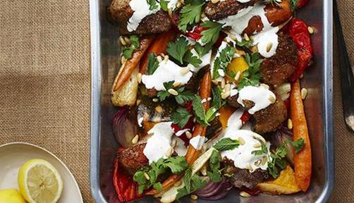 Spiced Lamb and Winter Vegetable Tray Bake with Yoghurt, Pine Nuts and Herbs